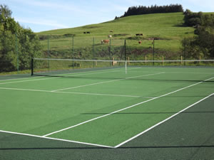 Self catering cottages with all weather tennis court